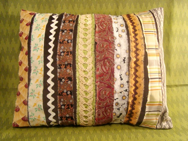finished pillow using scrap fabric and ribbon.