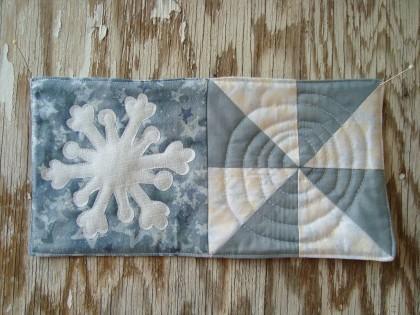 swirling snowflake mug rug