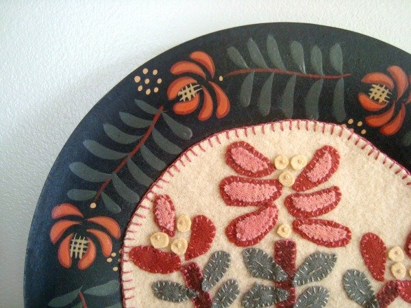 quilt blocks displayed in the center of a plate / patchworkposse.com