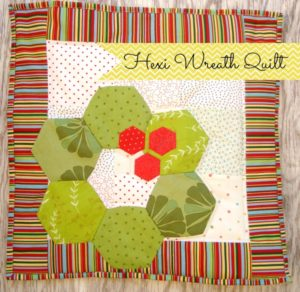 Sew a hexagon wreath mini quilt with patchwork posse. #holidaycraft #hexagon