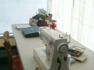 new sewing spot in the sun room. light and bright!
