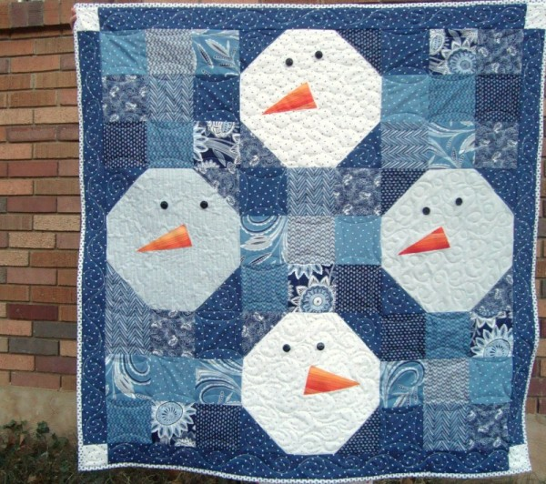 snowman quilt tutorial | patchworkposse - so cute! I love the simple design with the big snowman faces- perfect for winter snuggles. I'm thinking one of the boys would like this one for sure.