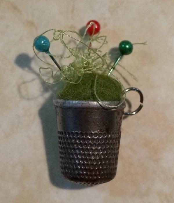 thimble pincushion with pins