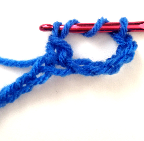 Crochet Stitch Quad Tr : Step 5: Yarn over and pull through the first two loops, leaving three ...