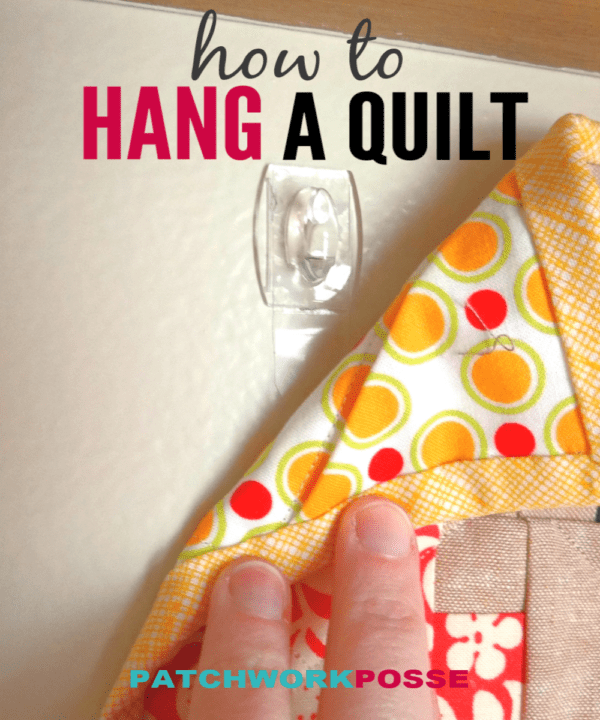 How to hang a mini quilt tutorial- learn how quick and simple it is with a couple of supplies!