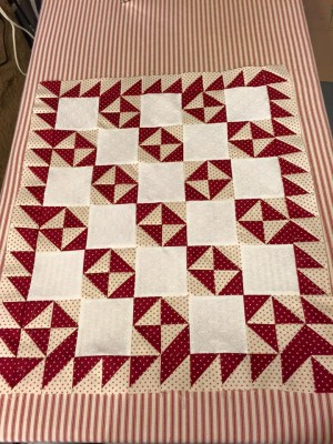 red broken dishes doll quilt
