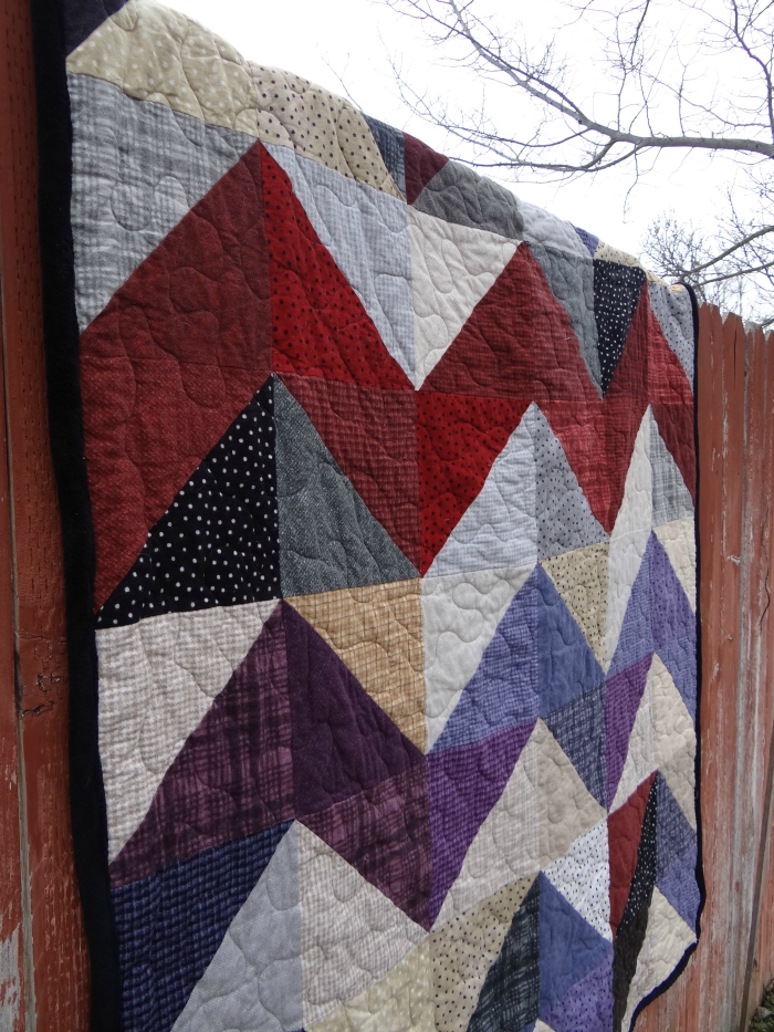 layer cake quilt - chevron style. love the lines of color!