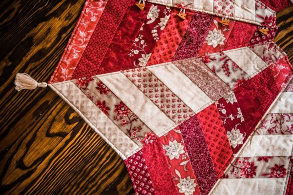 sewing the jelly roll strips wasnt hard at all and really didnt take much time they are long and youll have to be careful not to sew them all from the - Quilted Christmas Tree Skirt Pattern
