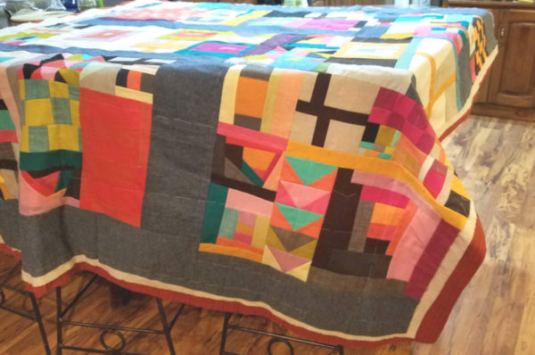 hand basting a quilt on the table