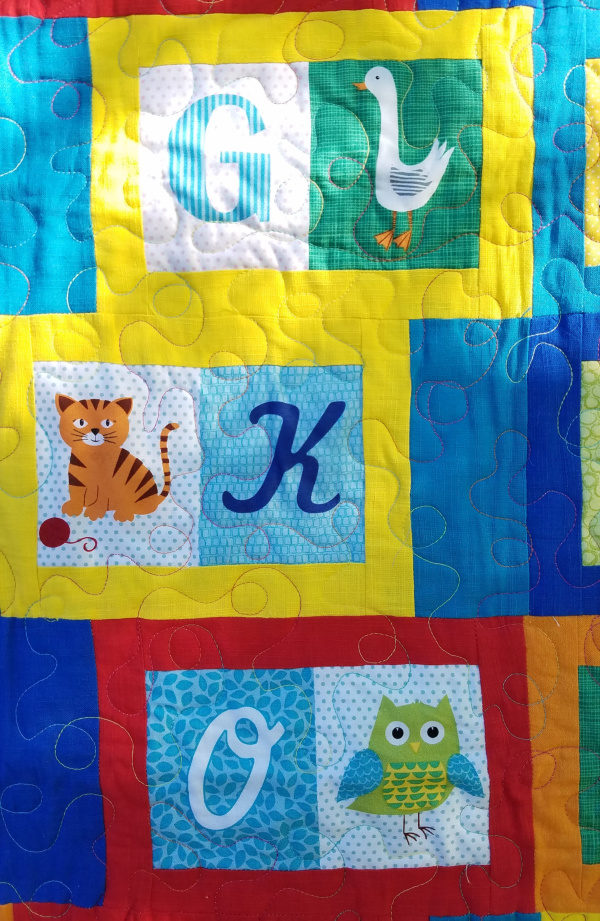How to Make a Quilt with Fabric Panels - You'll find out some fun layout ideas and options for using fabric panels in your quilts. Quickly finish your quilt!