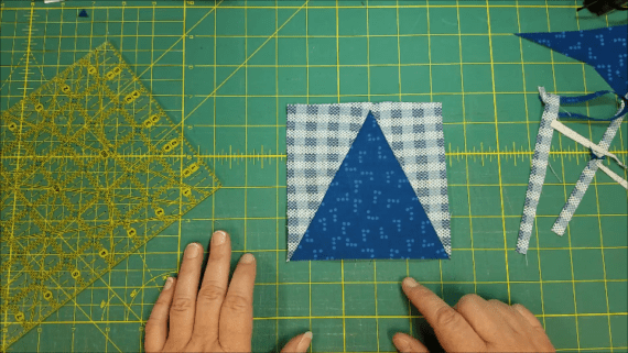 Learn how to sew up a fun quilt block that looks like skinny flying geese. Great for by itself or in a larger quilt block. Video tutorial instructions.